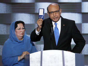 Khizr Khan, father of fallen US Army Capt. Humayun S. M. Khan, speaks during the final day of the 2016 Democratic National Convention, as his wife listens. Since, then Khan has openly feuded with Donald Trump in the media.