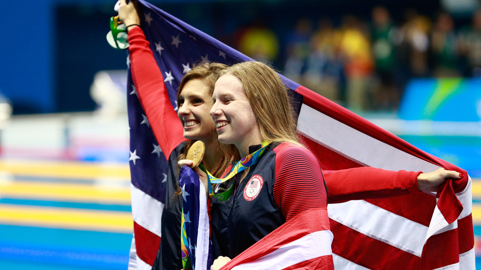 Gold medal winner Lilly King (right), seen here celebrating with her U.S. teammate and bronze medalist Katie Meili, won the 100-meter breaststroke over her rival, Russia's Yuliya Efimova.