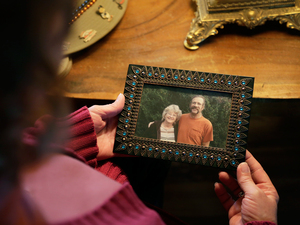Greta Horner holds a photo of her and her husband Ed taken a few months before he died.