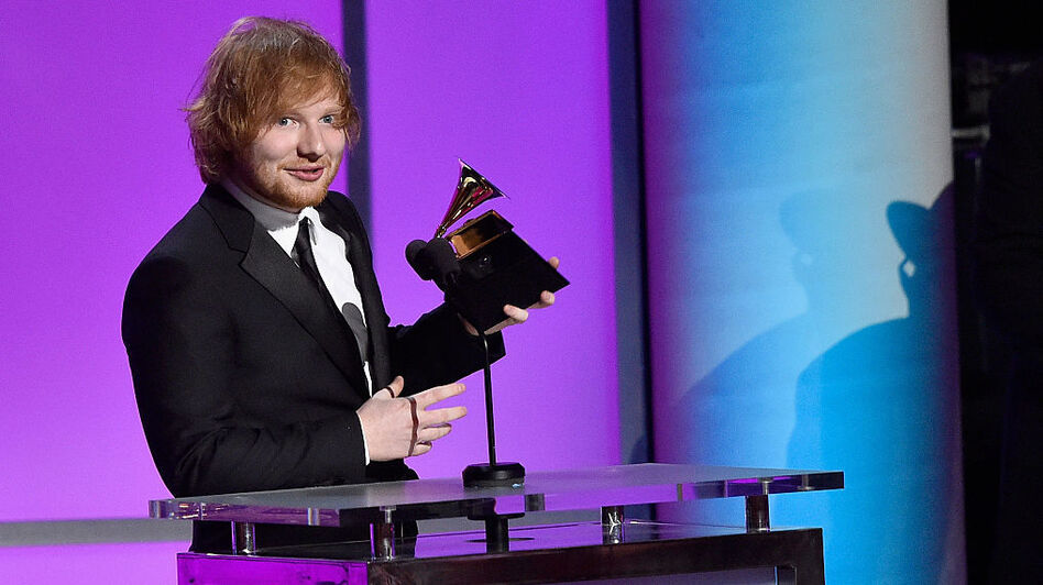 "Singer-songwriter Ed Sheeran accepting the Grammy for Best Pop Solo Performance for ""Thinking Out Loud"" in February 2016. (Getty Images)"