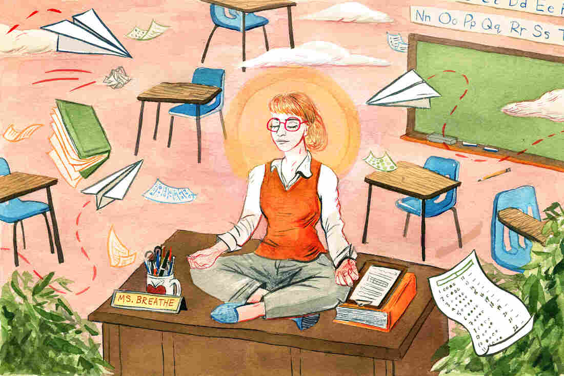 Teacher meditates on her classroom desk.