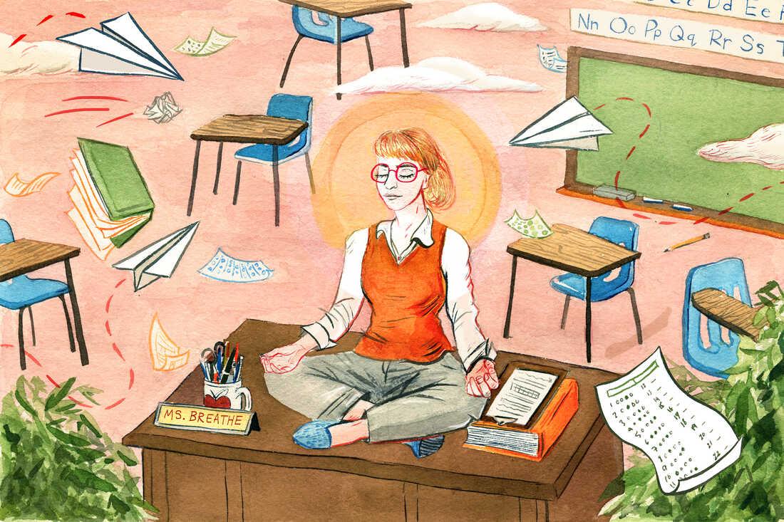 Teacher meditates on her classroom desk.