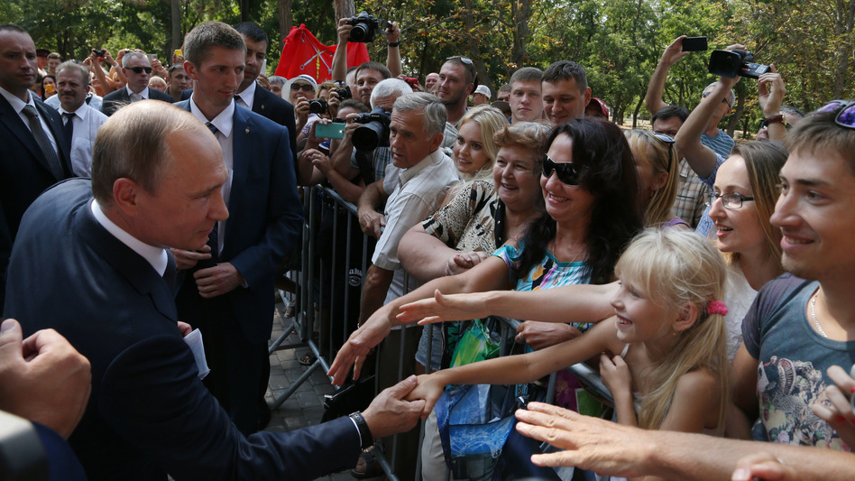 Russian President Vladimir Putin greets well-wishers on a visit to Crimea in August 2015. Russia seized and annexed the territory from Ukraine in March 2014. (Getty Images)
