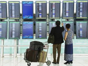 A couple checks flight schedules.