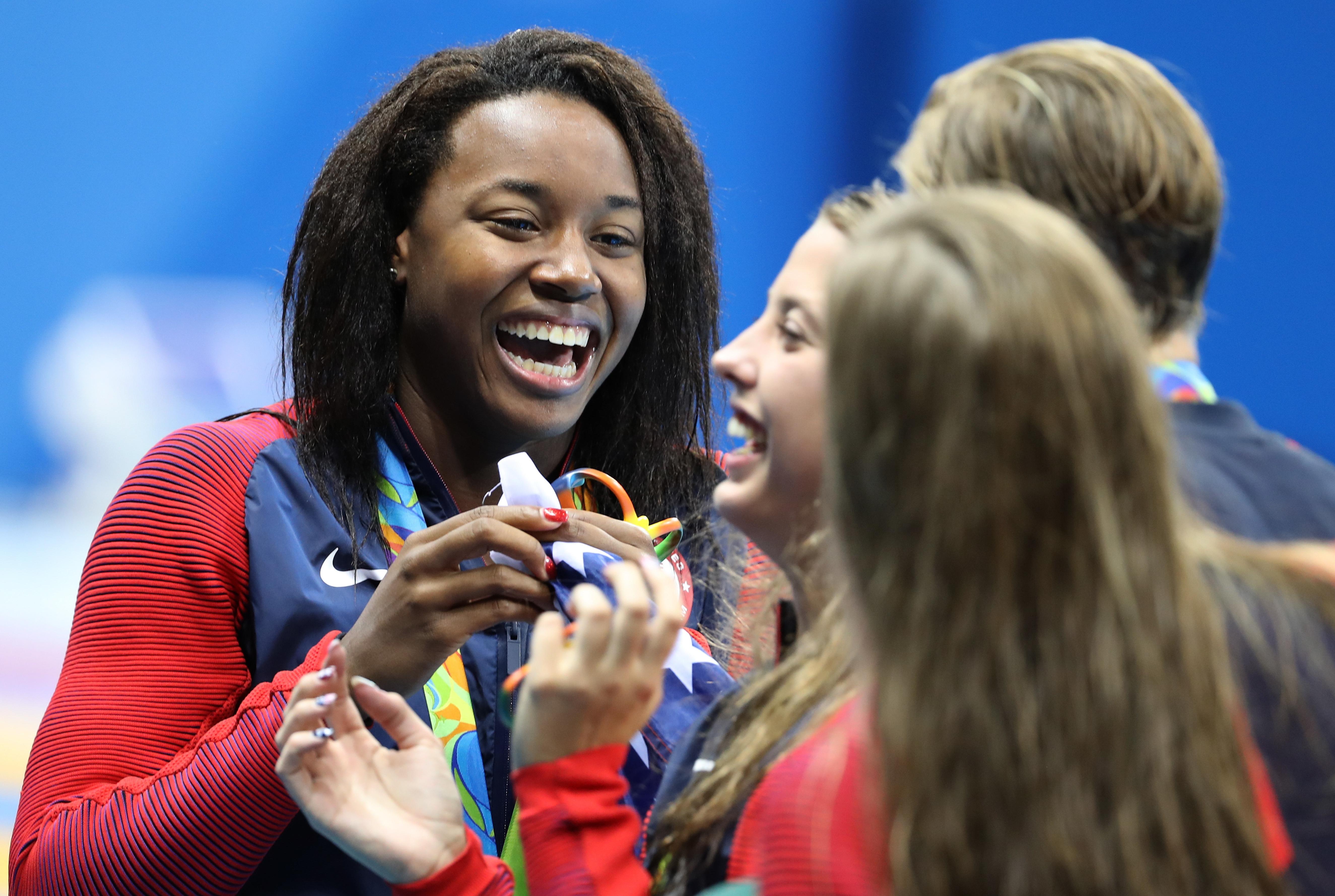 Phelps Helps U.S. Men Win Relay Gold In Rio; Manuel Helps Women Snare Gold