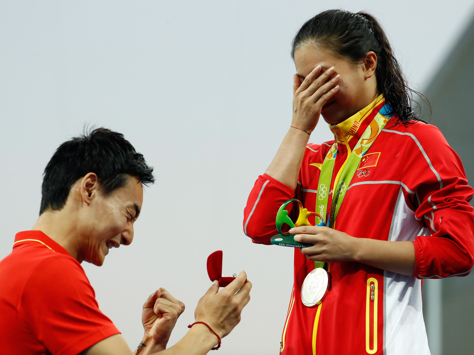 Chinese diver Qin Kai proposes marriage to He Zi, who had just received a silver medal in the women's diving 3-meter springboard final in Rio on Sunday. (Clive Rose/Getty Images)