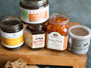 This 2014 photo shows an assortment of savory jams: (from left) Terrapin Ridge Farms balsamic garlic and herb jam, Wozz Kitchen Creations triple ale onion jam, The Prairie Gypsies red hot lover jam, Taste of Inspirations mango pepper jelly and Skillet Bacon Spread original bacon spread.