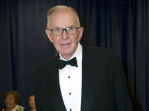 John McLaughlin arrives at the 2012 White House Correspondents' Association Dinner in Washington, D.C. McLaughlin, the conservative host of The McLaughlin Group television show that pioneered hollering-heads discussions of Washington politics, died Tuesday at the age of 89.