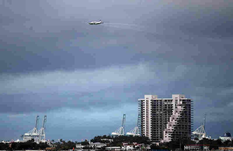 A plane sprays pesticide over parts of the city of Miami in the hope of controlling and reducing the number of mosquitos, some of which may be capable of spreading the Zika virus on August 12, 2016 in Miami, Florida. The CDC has advised pregnant women to avoid the Wynwood neighborhood of Miami where the majority of the 25 cases of people with the Zika virus have been found.