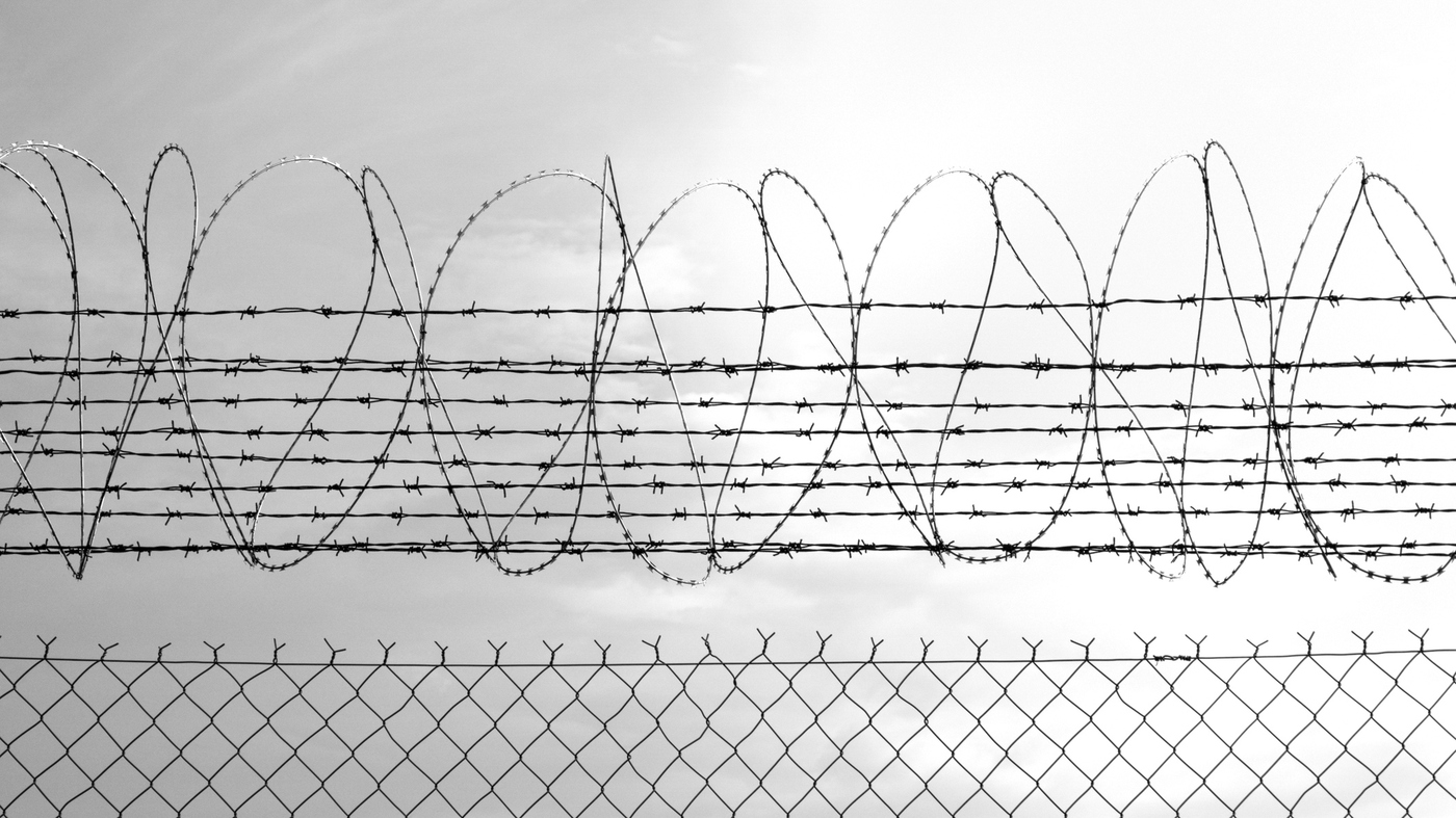 Prison Fence Graphic study: the growing, disproportionate number of women of color in