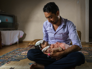 Syrian refugee Taher Hamada, 34, cares for his 4-month-old daughter, Tamara, at his apartment in Gaziantep, Turkey. His lack of documents makes it difficult, if not impossible, for him to travel, and could limit the opportunities for his daughter.