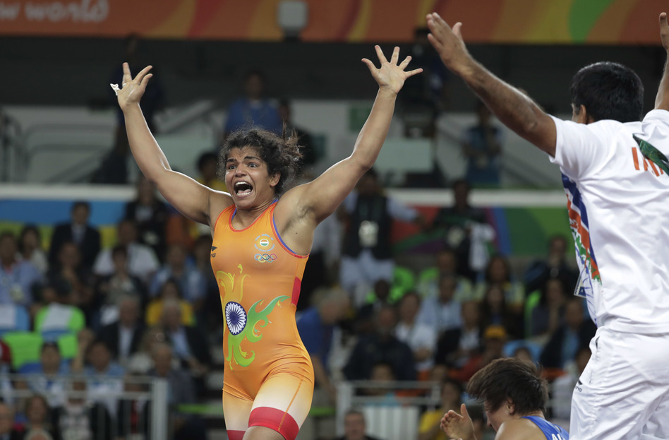 India's Sakshi Malik reacts after winning bronze in the women's wrestling freestyle competition. (Markus Schreiber/AP)