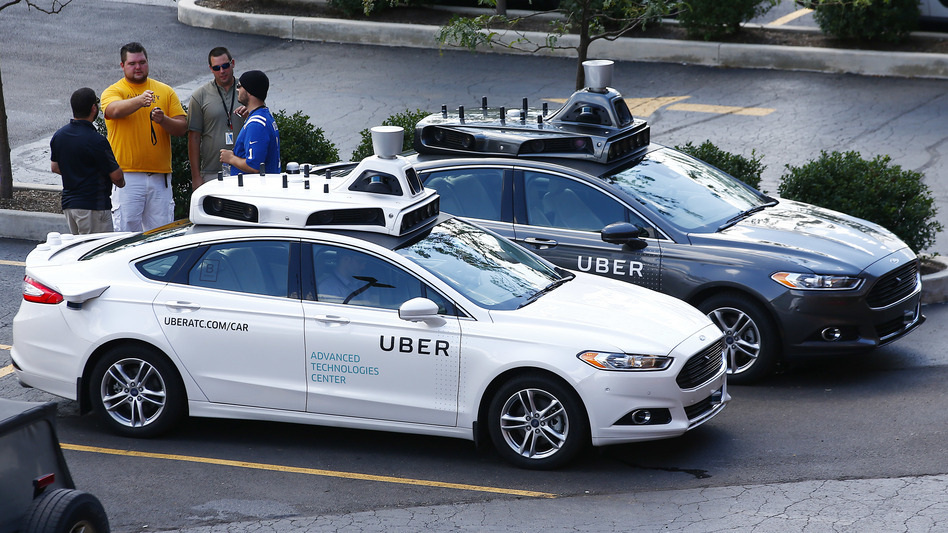 Ride-booking company Uber plans to offer customers self-driving cars in Pittsburgh soon. The vehicles will come with human backup drivers. (Jared Wickerham/AP)