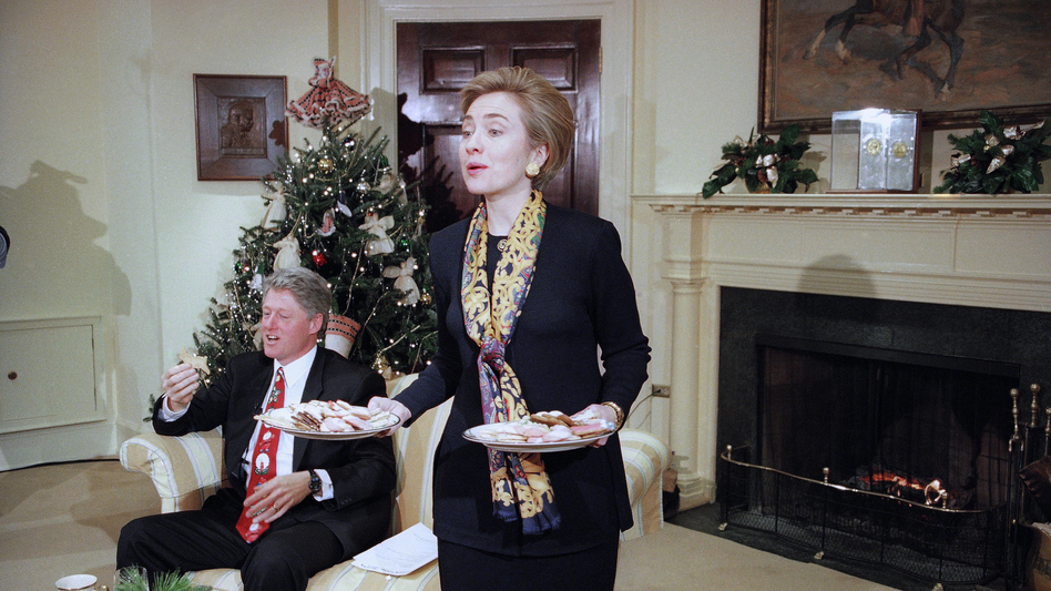First lady Hillary Clinton offers cookies to the Arkansas press corps during an interview with President Bill Clinton in the Roosevelt Room at the White House in 1993. (J. Scott Applewhite/AP)