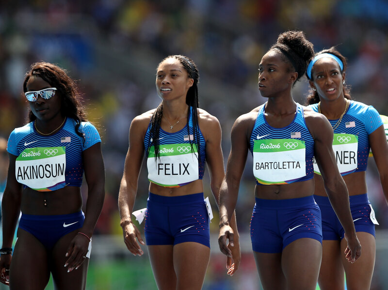 The U.S. women's 4x100m relay team — from left, Morolake Akinosun, Allyson Felix, Tianna Bartoletta and English Gardner — will get to rerun their race after an obstruction was called on Brazil's team, one lane over.