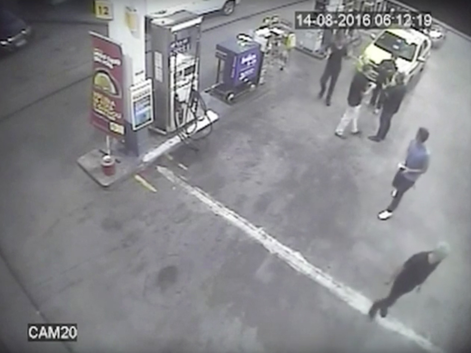 In this surveillance video frame released by Brazilian police, swimmers from the U.S. Olympic team appear with Ryan Lochte (right) at a gas station last weekend. A top Brazil police official said the swimmers damaged property at the gas station. (Brazil Police/AP)