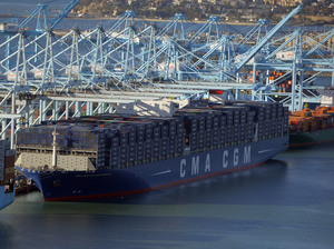 After its maiden voyage from China, the largest container ship to ever make port in North America, unloads its cargo in the Port of Los Angeles on Dec. 26, 2015. The major shipping companies in Europe and Asia began ordering the state-of-the-art, supersized ships back in 2011, when times were better.