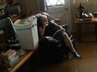 Elsie Lazarus is overcome with emotion Thursday as she sits in her flooded living room while retrieving what she can from her home in St. Amant, La.