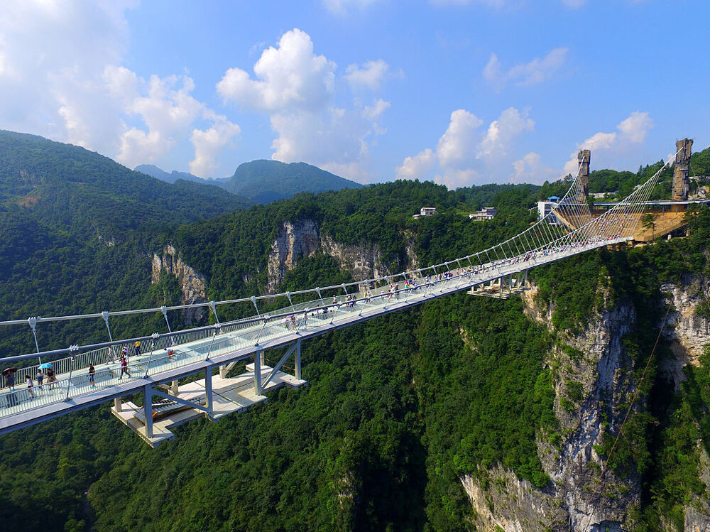 PHOTOS Welcome To The Worlds Highest And Longest Glass - China opens worlds longest skywalk