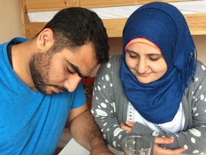 "Firas Awad (left) and wife Tamam Aldrawsha, from Syria, spend hours studying German every day. Awad wants to complete the pharmacy studies he abandoned because of the Syrian war, and Aldrawsha wants to become a nurse. ""I want to be useful,"" she says. ""Useful for my family and useful for this country."""