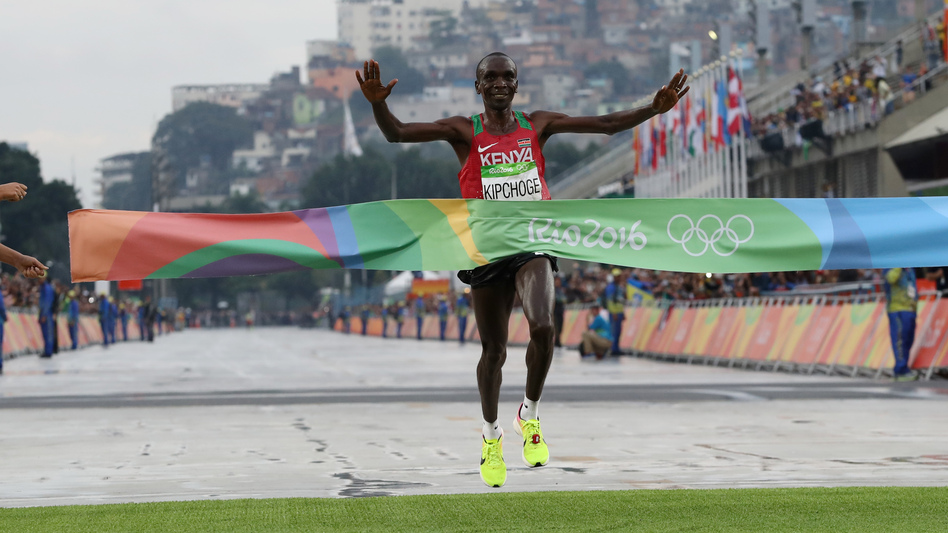 Kenya's Eliud Kipchoge crosses the finish line to win the men's marathon in Rio on Sunday. He won by more than a full minute. (Petr David Josek/AP)