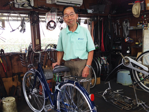 "Nenosuke Yamamoto, 80, stands in the shed where he repairs bicycles in Tokyo. ""I feel that if I keep on working, I might not age as much,"" he says. ""I might not have dementia or other sorts of aging issues."""