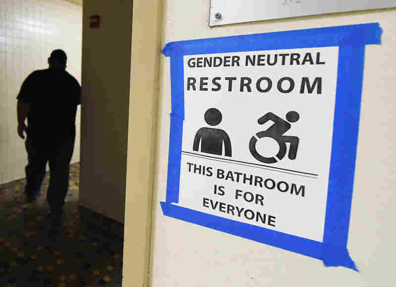 Signs are posted outside Santee High School's gender neutral restrooms at its campus in Los Angeles on May 4.