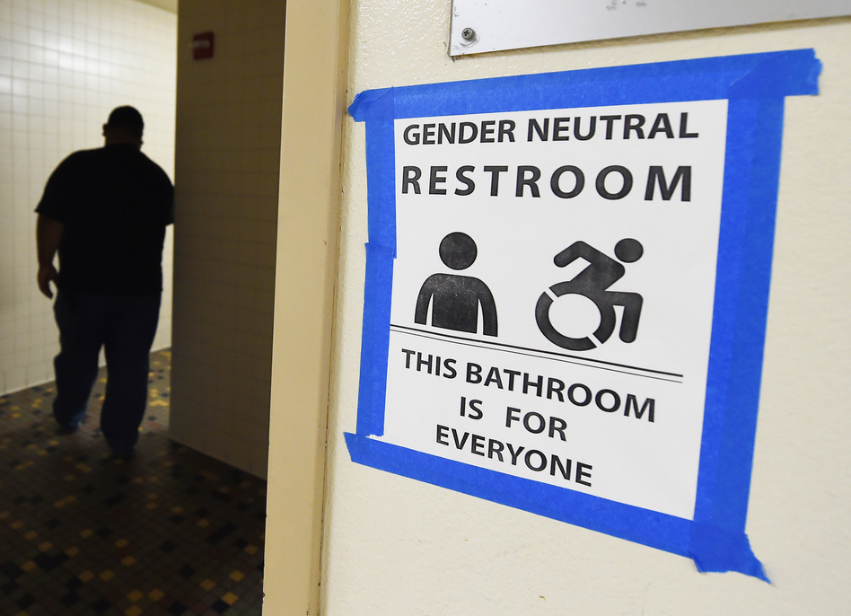 Signs are posted outside Santee High School's gender neutral restrooms at its campus in Los Angeles on May 4. (Mark Ralston/AFP/Getty Images)