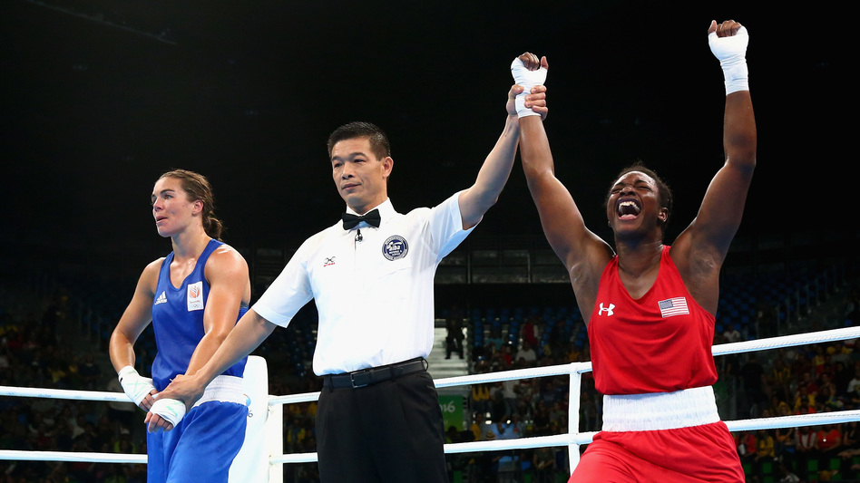 Claressa Shields of the United States (right) celebrates victory over Nouchka Fontijn of the Netherlands on Sunday. (Getty Images)