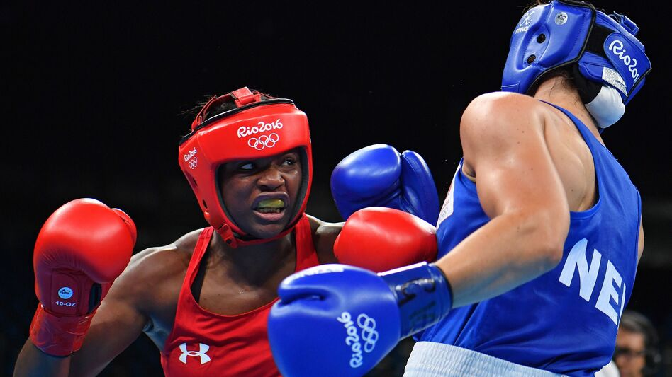 USA's Claressa Shields (left) fights against Netherlands' Nouchka Fontijn at the Rio 2016 Olympic Games. (AFP/Getty Images)
