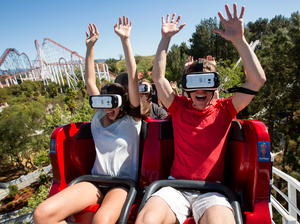 At Six Flags Magic Mountain in Valencia, Calif., riders of the New Revolution Virtual Reality Coaster wear VR goggles to play a video game while the roller coaster twists and turns.