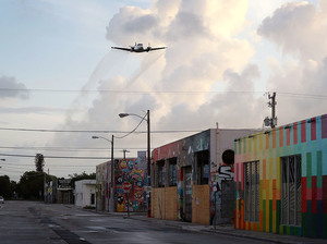 A plane sprays pesticide over the Wynwood neighborhood of Miami on Aug. 6. That's just one way health officials are battling back Zika-carrying mosquitoes in the area.