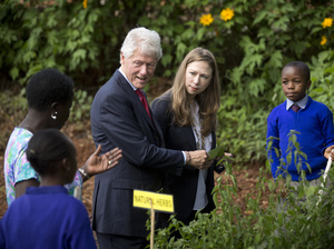 Former President Bill Clinton and daughter Chelsea Clinton tour a primary school's garden in Nairobi, Kenya, last year as part of a tour of the Clinton Foundation's projects in the country.