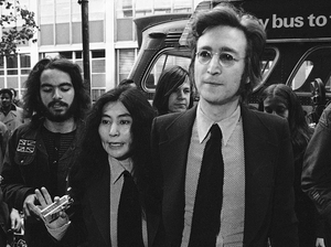 Yoko Ono, John Lennon, and their immigration attorney Michael Wildes (right), leave the Immigration and Naturalization Service in New York City on March 16, 1972.