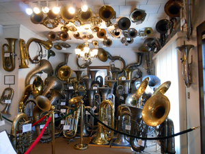 Single-belled baritones and euphoniums line the ceiling of the V&E Simonetti Historic Tuba Collection to make room the bigger instruments on the floor and walls.