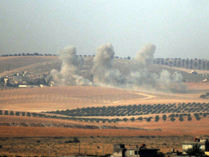 Smokes billow in the Syrian border area, photographed Wednesday from across the border in Karkamis, Turkey.