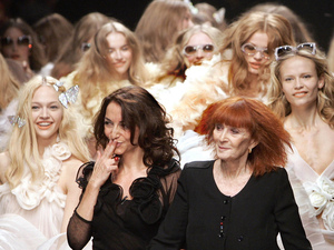 French designer Sonia Rykiel (right) and her daughter, Nathalie Rykiel, artistic director for the fashion house Rykiel, greet the crowd after the presentation of their Spring-Summer 2008 Ready-to-Wear collection, in Paris in 2007.