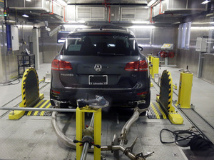 A Volkswagen Touareg diesel is seen being tested at a federal facility in Michigan last year. Volkswagen has reached a tentative deal with its U.S. dealers to compensate them for plummeting sales as a result of the company's emissions cheating scandal.
