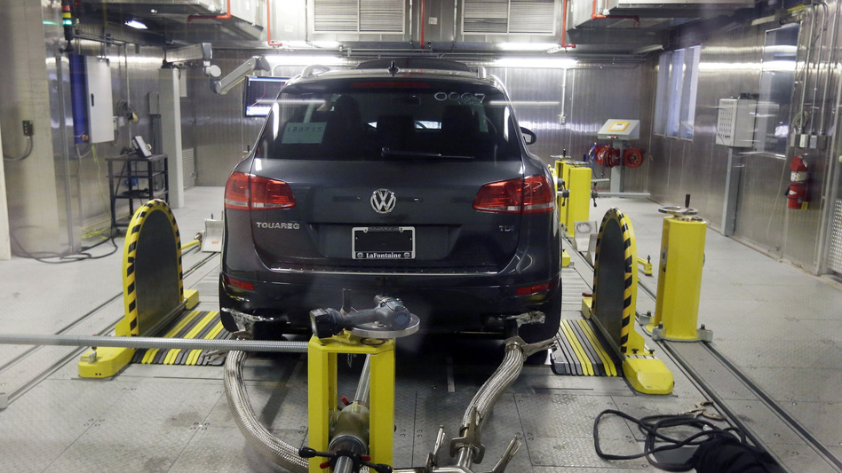 A Volkswagen Touareg diesel is seen being tested at a federal facility in Michigan last year. Volkswagen has reached a tentative deal with its U.S. dealers to compensate them for plummeting sales as a result of the company's emissions cheating scandal. (AP)