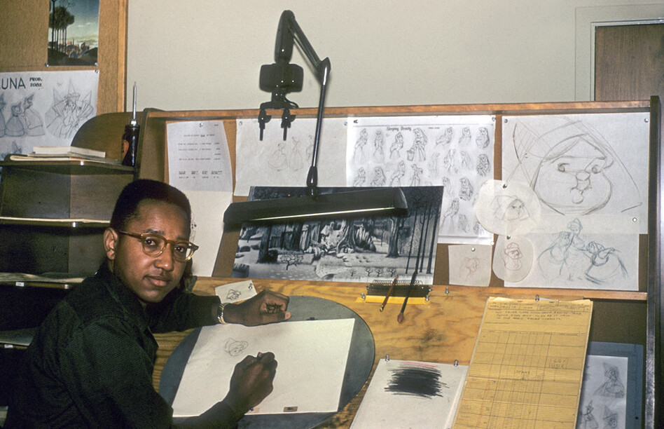 "Floyd Norman was Disney's first African-American animator. He's shown above in 1956, working as an ""apprentice inbetweener"" on <em>Sleeping Beauty.</em> (Michael Flore Films/Falco Ink.)"