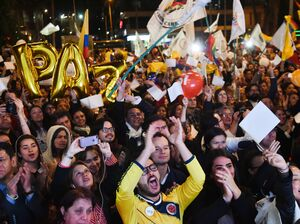 Colombians celebrate in Bogota on Wednesday as they watch on a giant screen broadcasting the signing of a peace agreement between the Colombian Government and the FARC in Havana.