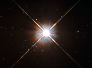 Proxima Centauri lies in the constellation of Centaurus (The Centaur), just over four light-years from Earth. Although it looks bright through the eye of Hubble, Proxima Centauri is not visible to the naked eye.