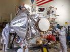 Workers assemble OSIRIS-REx in a clean room at Lockheed Martin. Solar panels were added afterward to power the voyage.