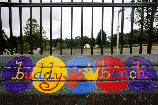 A playground bench is colorfully decorated at the new Sandy Hook Elementary School.