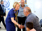 The U.S. ambassador to Jordan, Alice Wells, shakes hands with Syrian refugees Sunday ahead of their departure to the United States.