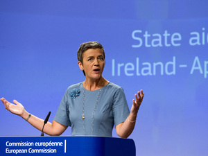 European Union Competition Commissioner Margrethe Vestager speaks during a media conference at EU headquarters in Brussels on Tuesday,. The European Union says Ireland has given illegal tax benefits to Apple Inc. and must now recover the unpaid back taxes from the U.S. technology company, plus interest.