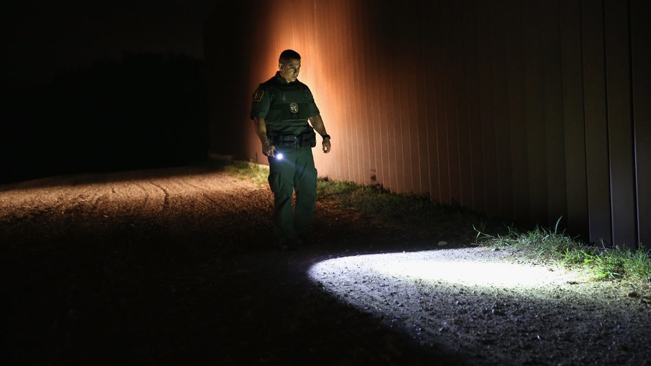 A Border Patrol agent checks for footprints near the U.S. border with Mexico on April 13 in Weslaco, Texas. (John Moore/Getty Images)