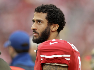 San Francisco 49ers quarterback Colin Kaepernick stands on the field during an NFL football game against the Atlanta Falcons in Santa Clara, Calif.
