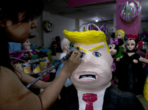 Alicia Lopez Fernandez paints a piñata depicting Donald Trump at her family's store, Piñatas Mena Banbolinos, in Mexico City in 2015.