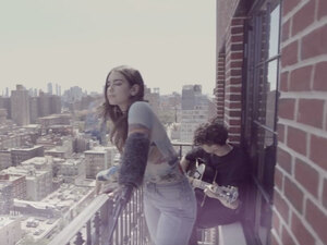 "Dua Lipa performs ""Thinking Bout You"" on a balcony in New York City's Lower East Side."
